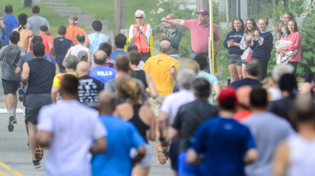 Spectators cheer for runners in the Old Hallowell Day 5K on Saturday in Hallowell. There were 157 finishers in the early morning 3.1 mile road race that was followed up by a kids' fun runs in Vaughan Field.