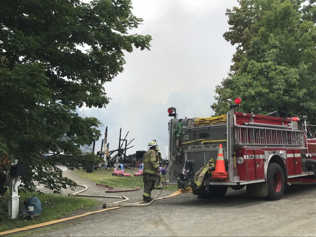 Firefighters battle a blaze Monday morning that destroyed a house on Hillcrest Drive in Chelsea.