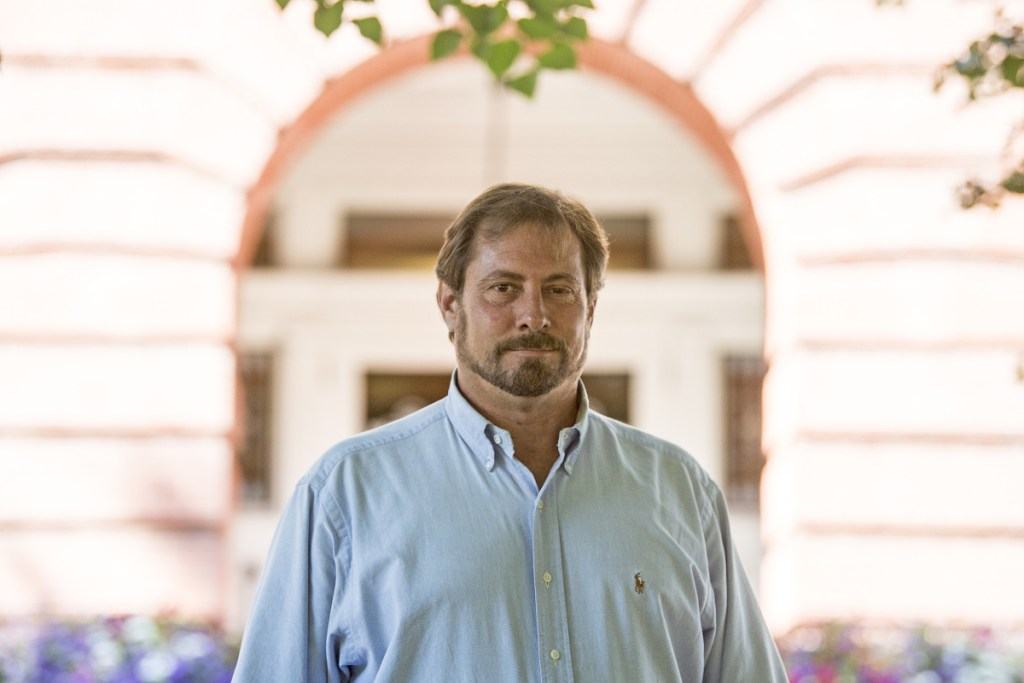 Mark Andre, the Republican candidate running against incumbent Democrat Colleen Madigan for the House 110 seat in the Legislature, poses for a portrait in front of Waterville City Hall on Wednesday. Madigan has received her initial allotment of Clean Elections funds. Andre has not.