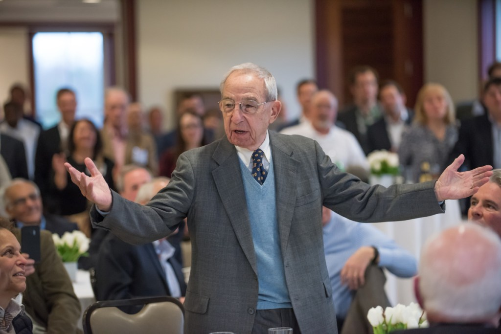 "John ""Swisher"" Mitchell raises his arms during an April 2017 ceremony at Colby College in which the school announced the creation of the John ""Swisher"" Mitchell Assistant Coach for the men's basketball program. It was the first endowed assistant coaching position in the New England Small College Athletic Conference. Mitchell died Wednesday. He was 91."