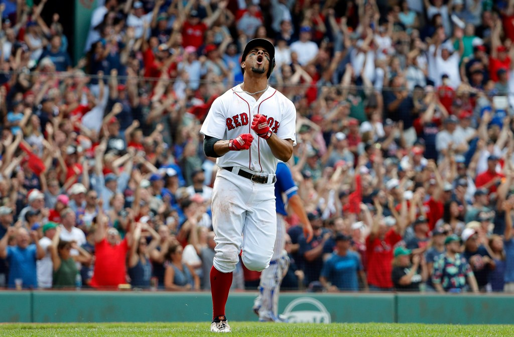 Boston's Xander Bogaerts shouts while rounding the bases after hitting a grand slam in the 10th inning of the Red Sox' 6-2 win over the Toronto Blue Jays on Saturday in Boston.