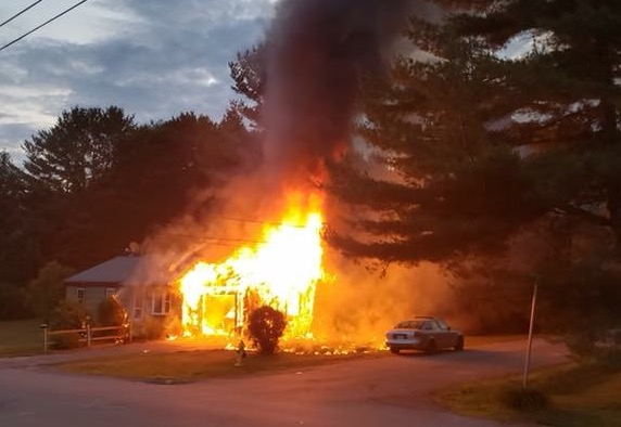 The garage of the home on Rogers Road in Yarmouth burns Thursday night.