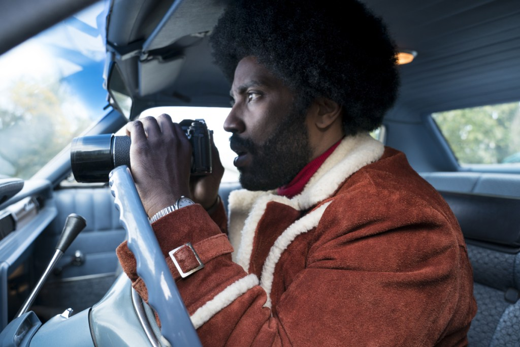"This image released by Focus Features shows John David Washington in a scene from ""BlacKkKlansman."""