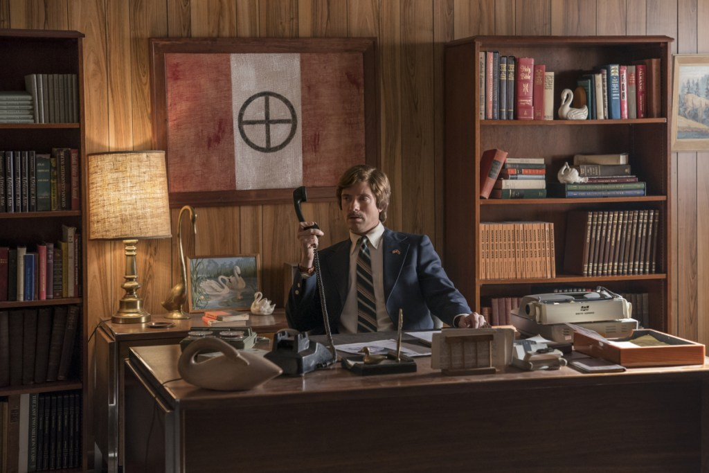 "This image released by Focus Features shows Topher Grace in a scene from ""BlacKkKlansman."""