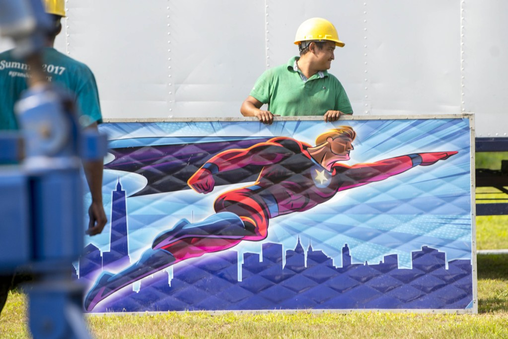 Antonio Hernandez sets up a portion of the Sky Diver ride as crews get ready for the 200th annual Skowhegan State Fair at the Skowhegan Fair Grounds on Wednesday.