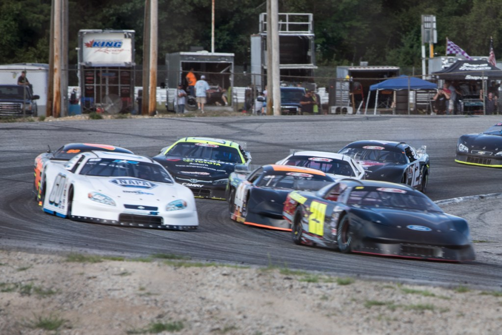 Three-time track champion Tim Brackett (60) races on the outside of Austin Teras (29) during a Pro All Stars Series race at Oxford Plains Speedway in July. Despite all of his success at Oxford, Brackett has never won the Oxford 250.