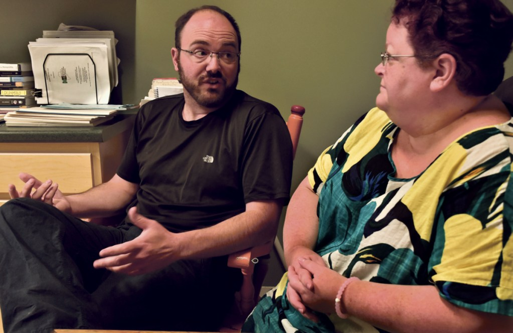 Mike Brown, former president of the board at the Humane Society Waterville Area, and current director Lisa Oakes discuss the financial condition of the Waterville facility on Wednesday. The shelter is launching a $250,000 capital campaign Monday to stave off possible closure in three months.