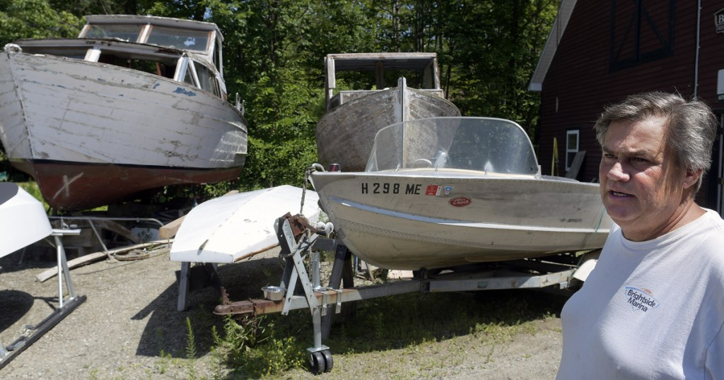 Shawn Grant in the boatyard July 16 at Brightside Marina, the business he owns in Belgrade Lakes Village. Grant is appealing the denial of a commercial business permit for the boat repair and slip company he has operated for 10 years on Hulin Road.