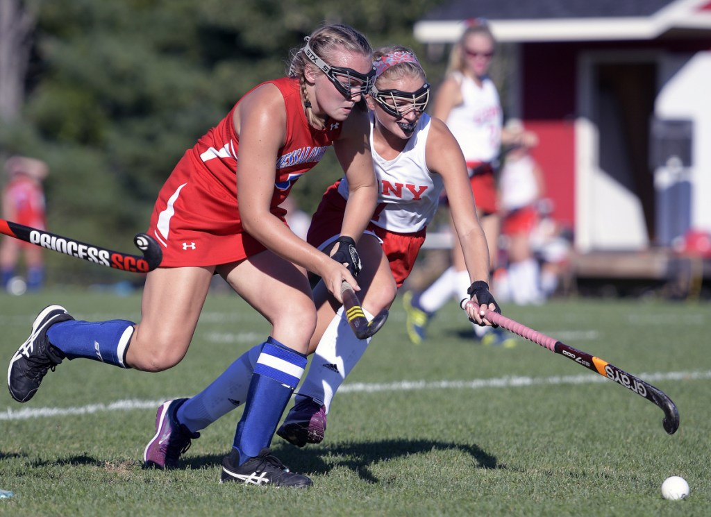 Cony's Julia Reny, right, pursues the ball with Messalonskee's Autumn Littlefield during a field hockey game Thursday in Augusta.