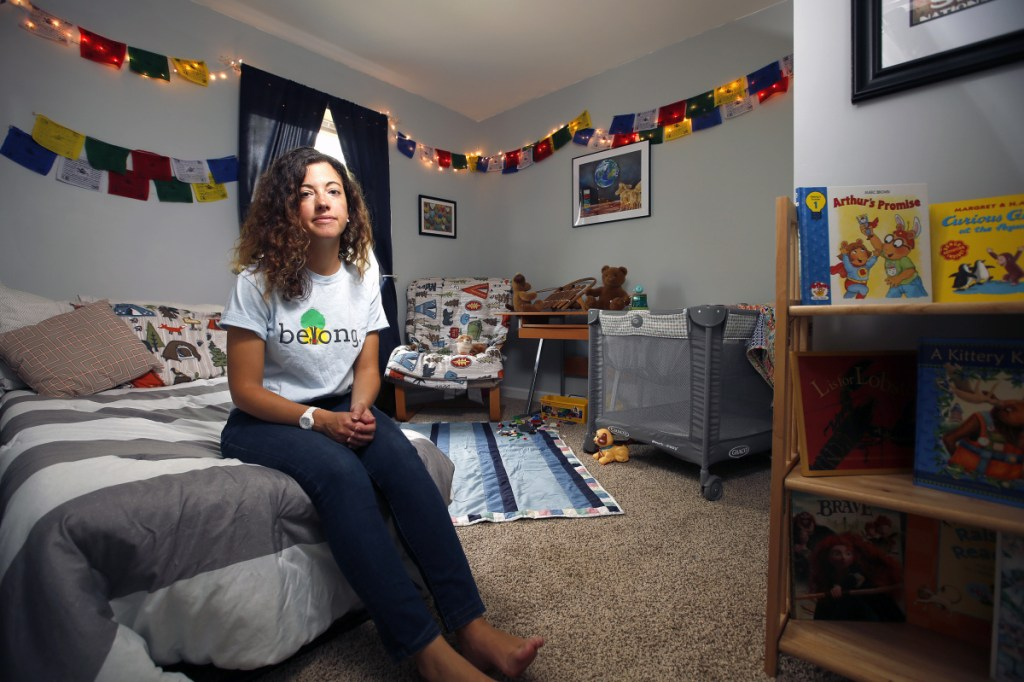 Stefanie Millette sits in the room she uses for the children she has taken into her Freeport home as a foster parent.