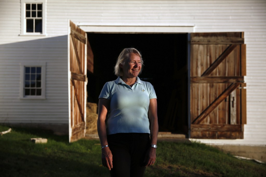 Susan Thornton poses for a portrait on the Packard-Littlefield farm, which she recently purchased.
