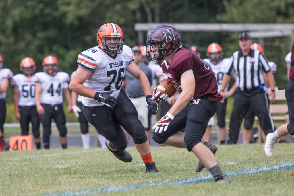 Nokomis' Alex Costedio carries the ball past Winslow's Ronan Drummond during a game Saturday in Newport.