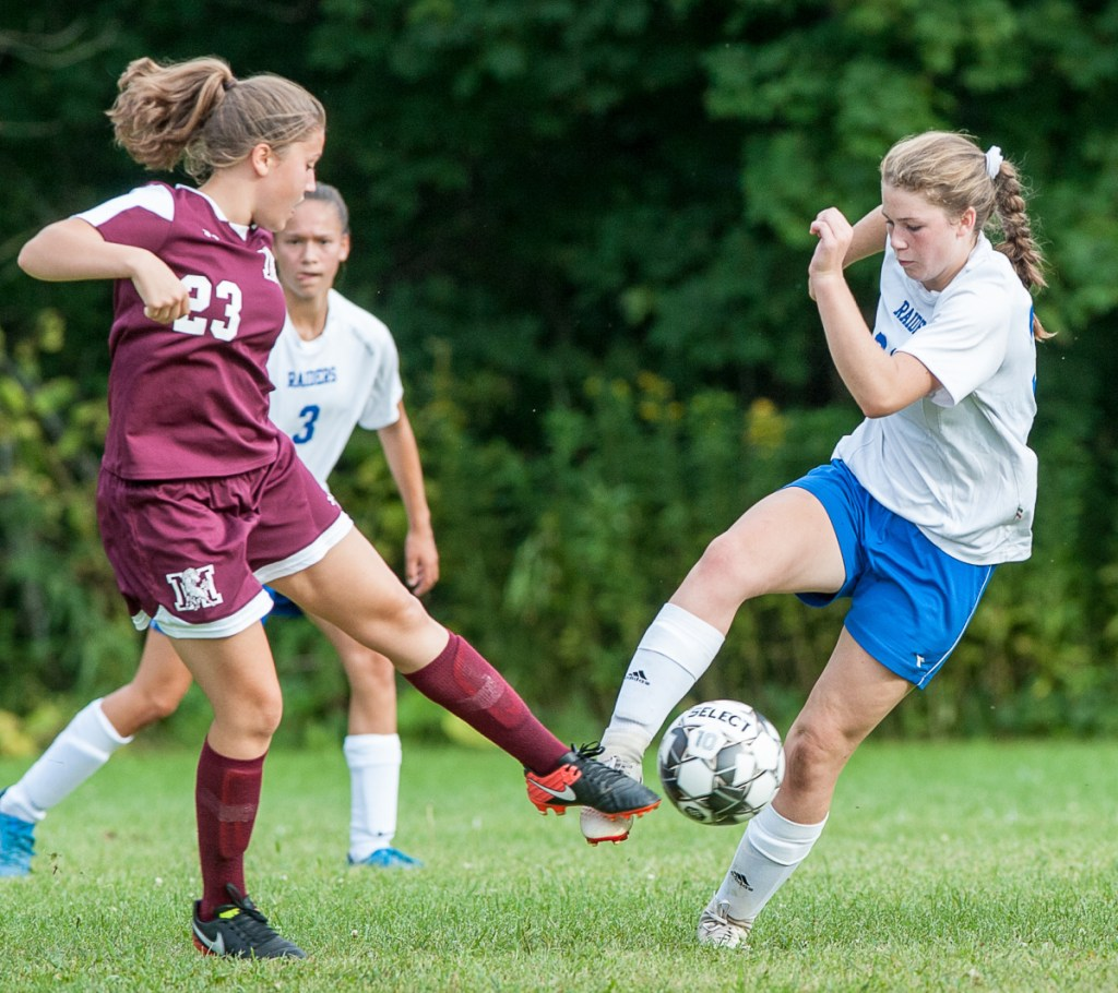 Monmouth's Amaya Bauer, left and Oak Hill's Julia Noel battle for the ball during Tuesday's game in Monmouth.