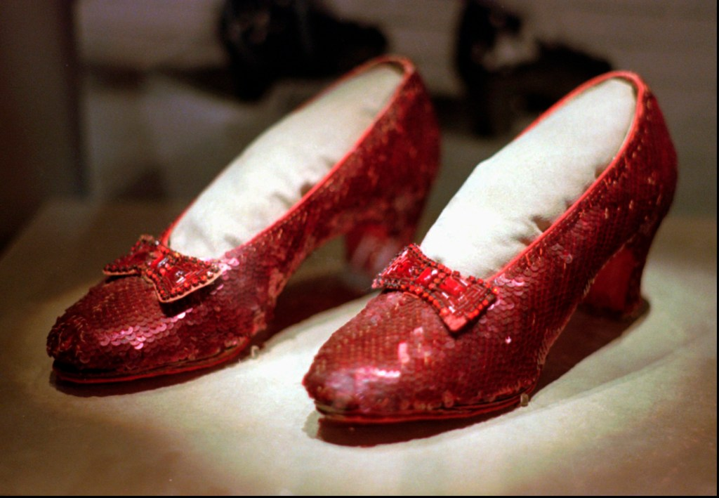 """This April 10, 1996, file photo shows one of the four pairs of ruby slippers worn by Judy Garland in the 1939 film """"The Wizard of Oz"""" on display during a media tour of the """"America's Smithsonian"""" traveling exhibition in Kansas City, Mo. Federal authorities say they have recovered a pair of ruby slippers worn by Garland that were stolen from the Judy Garland Museum in Grand Rapids, Minn., in August 2005 when someone went through a window and broke into the small display case. The shoes were insured for $1 million."""