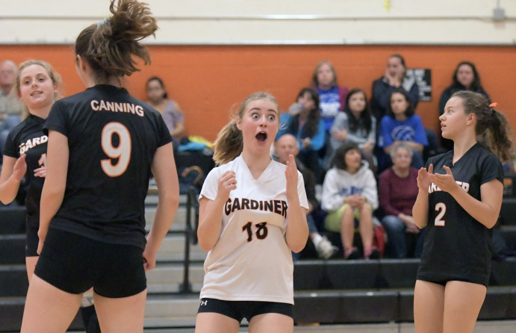 Gardiner's Elly Basinger, center, reacts to a point during a volleyball match Thursday in Gardiner.