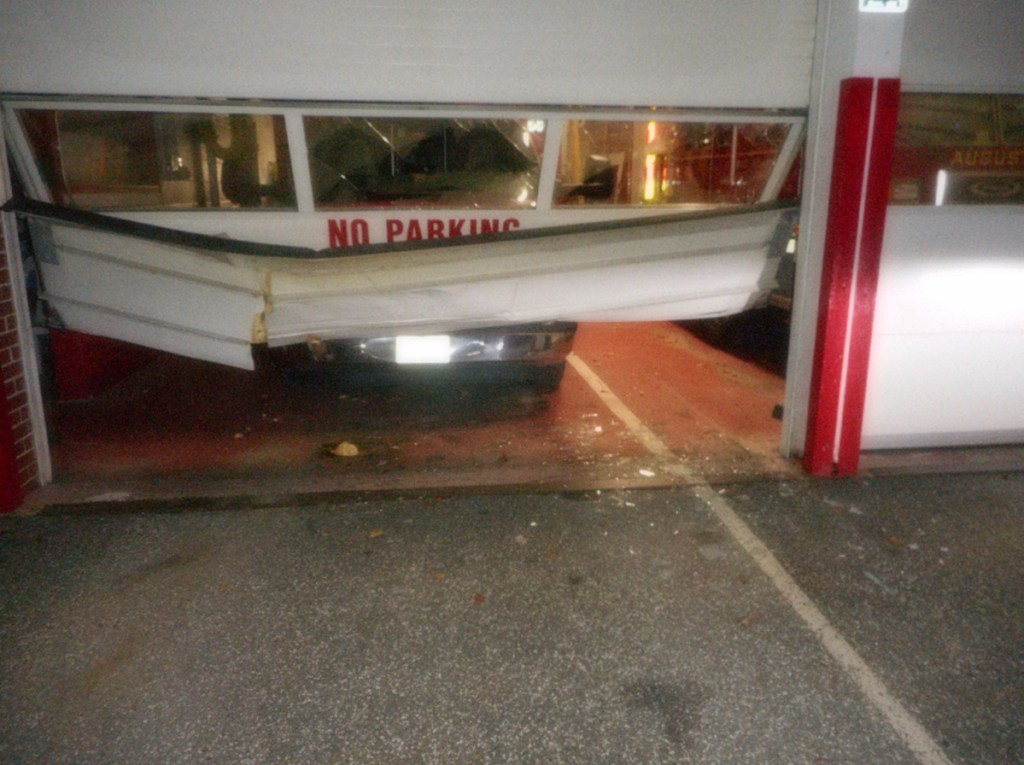 A car hit a bay door at Daryl Parker Wells Fire Station on Bangor Street in Augusta on Sunday. Thomas Cloutier, 57, was arrested in connection with the incident.