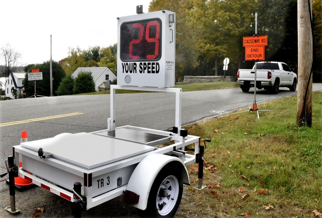 A portable radar unit clocks speed of a motorist at the intersection of the closed Causeway Road and Main Street in China on Tuesday.