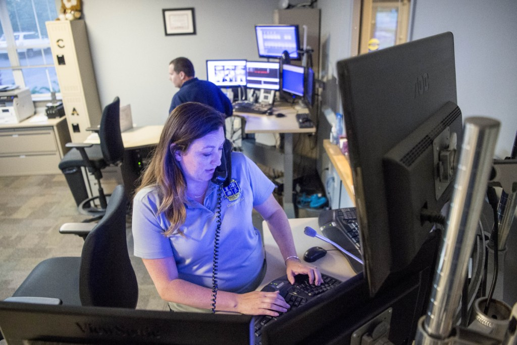 Police dispatcher Kecia Blaisdell answers a call June 15 at the Waterville police dispatch center at the Waterville Police Department.