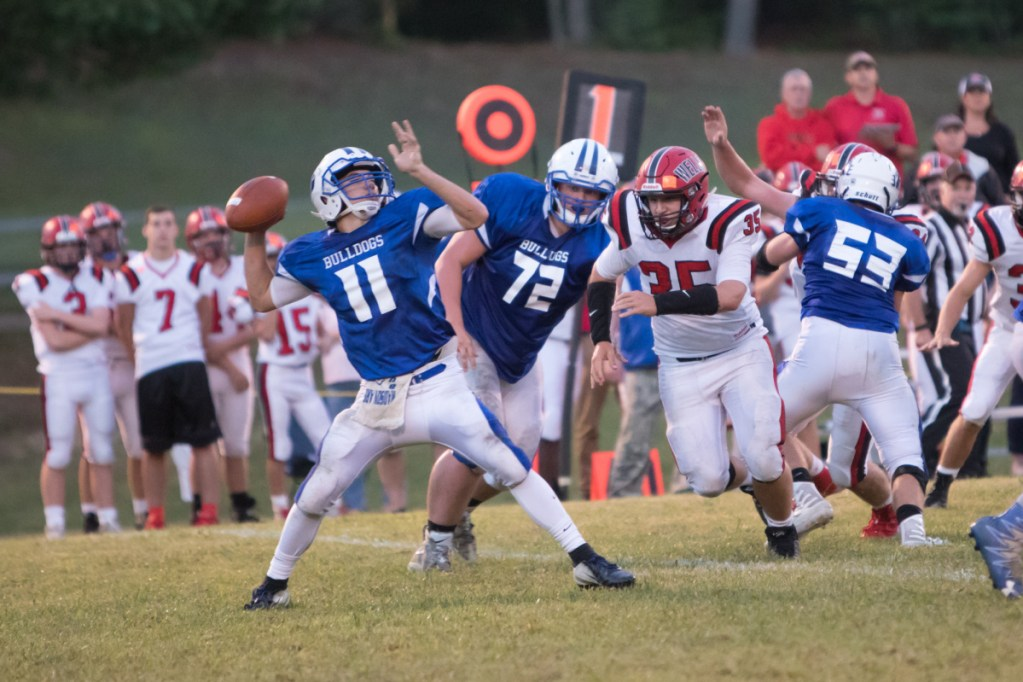 Madison quarterback Eric Wescott gets ready to air out a pass during a game against Wells earlier this season.