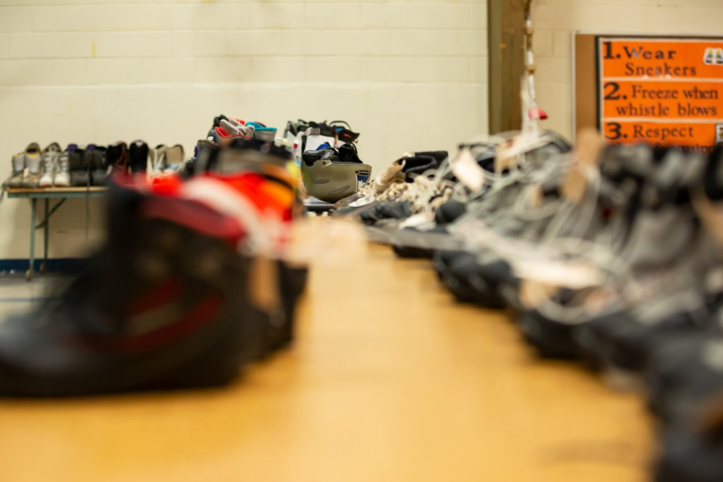 Tables are covered with hockey, alpine skiing and Nordic skiing equipment as part of the Central Maine Ski-Skate Swap on Saturday at the George G. Mitchell School in Waterville.