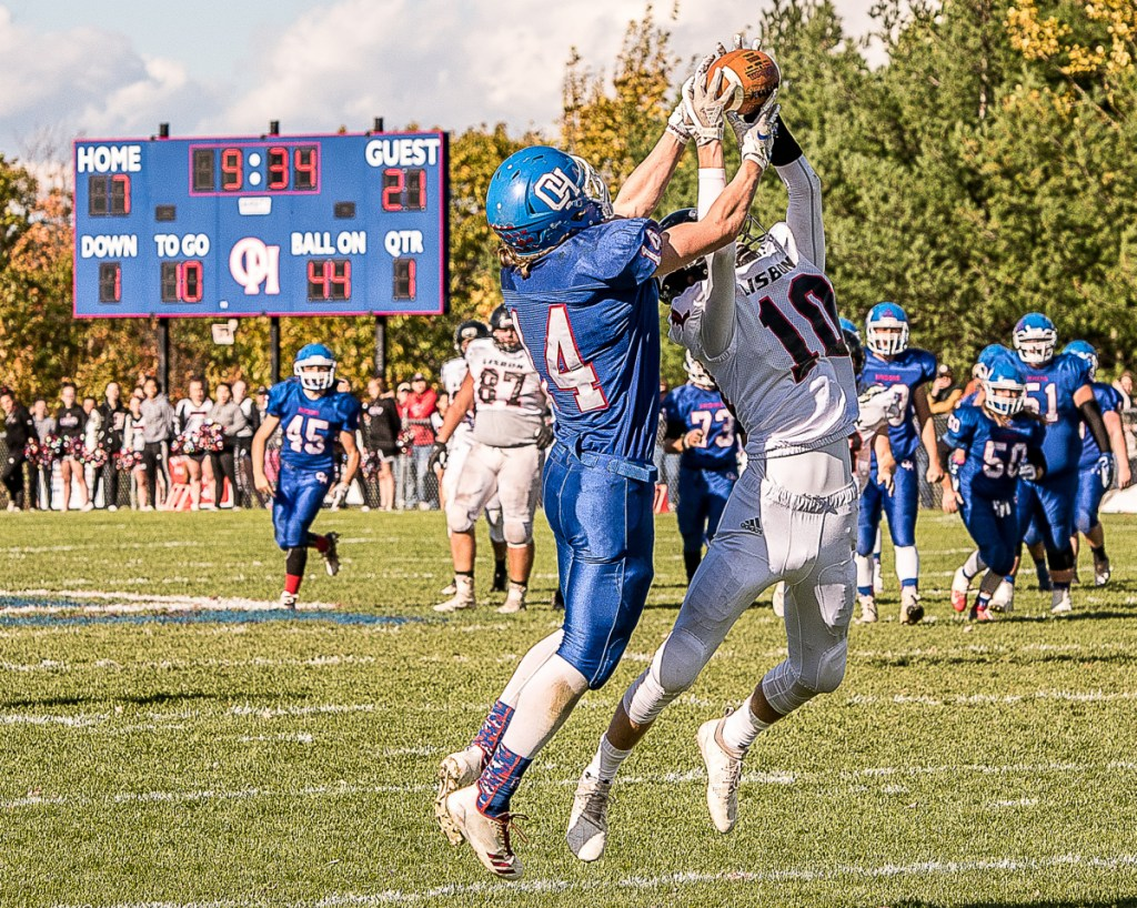 Oak Hill's Sam Lindsay and Lisbon's Seth Leeman both leap for a ball intended for Linsday in the first quarter Saturday in Wales. The ball was dropped.