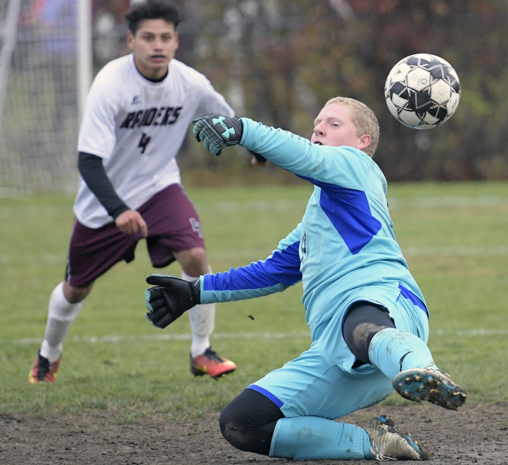 Gardiner keeper Timmy Doyle can't stop this Washington Academy shot during a Class B North quarterfinal game Tuesday in Gardiner.