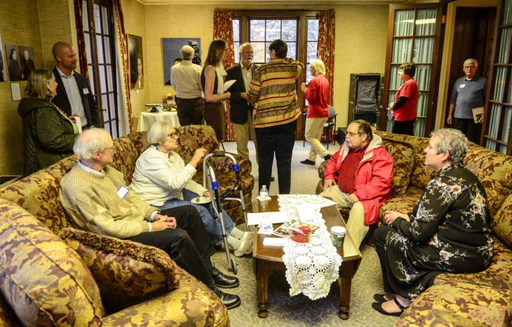 People chat in a downstairs room Tuesday at the First Amendment Museum in Augusta.
