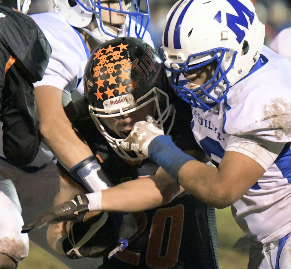 Gardiner's Nate Malinowski is tackled by the Morse defense during a Class C South quarterfinal game Friday in Gardiner.
