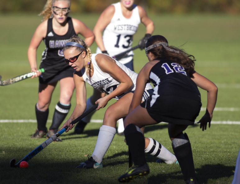 WESTBROOK, ME - OCTOBER 16: Westbrook senior Alexis Witham (12) tries to get the ball past Marshwood sophomore Isabella Schultze (12) during their playoff game at Westbrook High School on Tuesday, October 16, 2018. (Staff photo by Brianna Soukup/Staff Photographer)