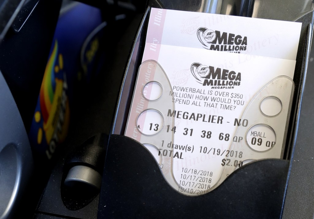 Mega Millions lottery tickets are printed out of a lottery machine at a convenience store Wednesday in Chicago. The estimated jackpot for Friday's drawing would be the second-largest lottery prize in U.S. history with a jackpot estimated to be $1 billion.