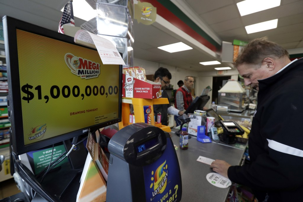 A sign displays the estimated Mega Millions jackpot at a convenience store in Chicago on Friday. No one won Friday's jackpot of $1 billion, the second-largest prize in U. S. lottery history.