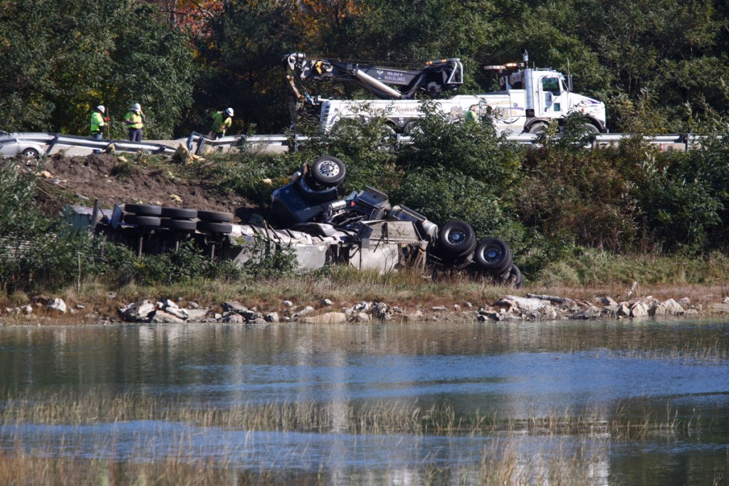 A tractor-trailer rollover on Interstate 295 southbound is seen from Presumpscot Street in Portland on Friday. The truck's milk and fuel had to be pumped out before the wreckage could be removed, police said.