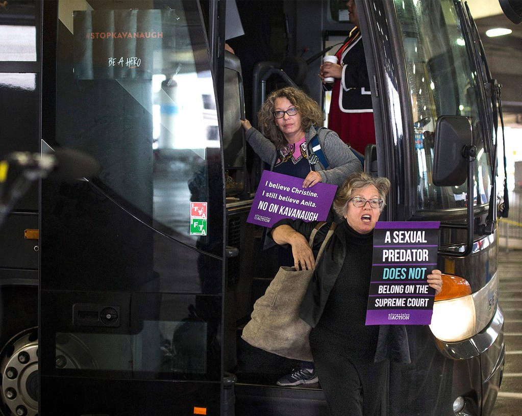 """Susan Feiner, front, gets off a bus at Union Station in Washington, D.C., with a group of Mainers on Oct. 4. The group traveled from Maine overnight in hopes of meeting with Sen. Susan Collins to voice their opposition to then-Supreme Court nominee Brett Kavanaugh. Feiner, a retired USM professor, has been barred from teaching because she offered students a """"pop-up"""" course for credit to take the bus to D.C. with demonstrators."""