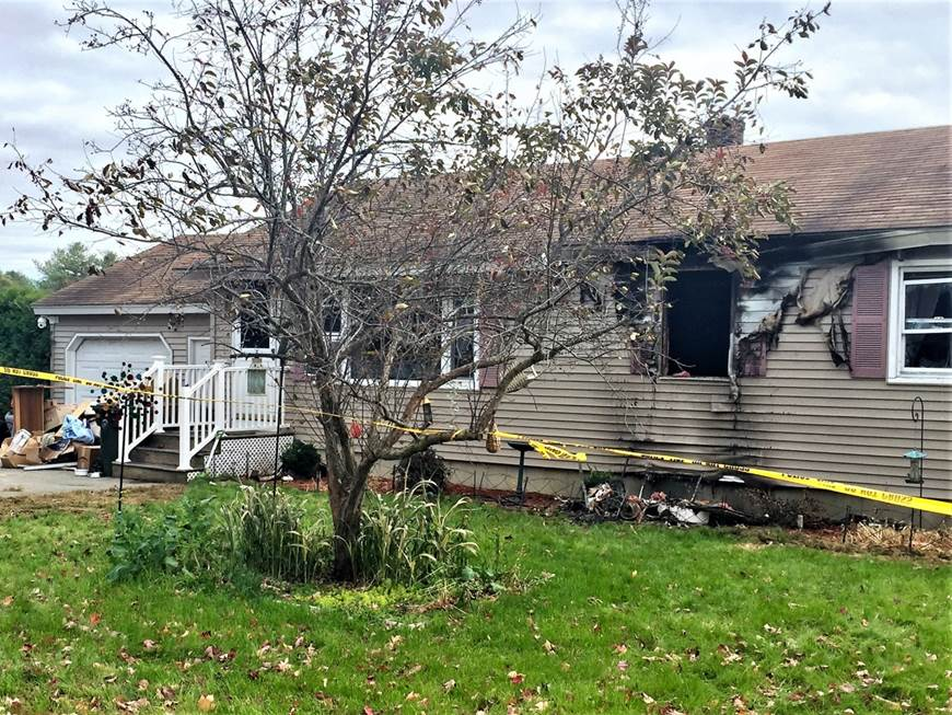 An 83-year-old woman died in a fire at this Saco home Saturday, officials say. (Staff photo by Liz Gotthelf)