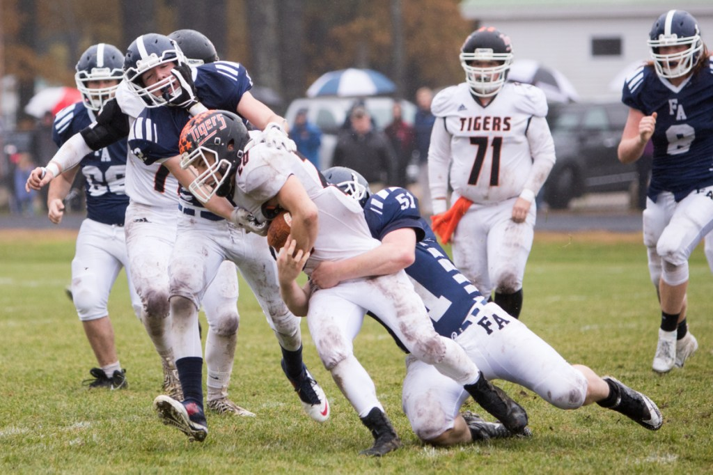 GF3 - Gardiner's Nate Malinowski is tackled by Fryeburg's Reese Kneissler in a Class C South semifinal game Saturday at Fryeburg Acedemy.