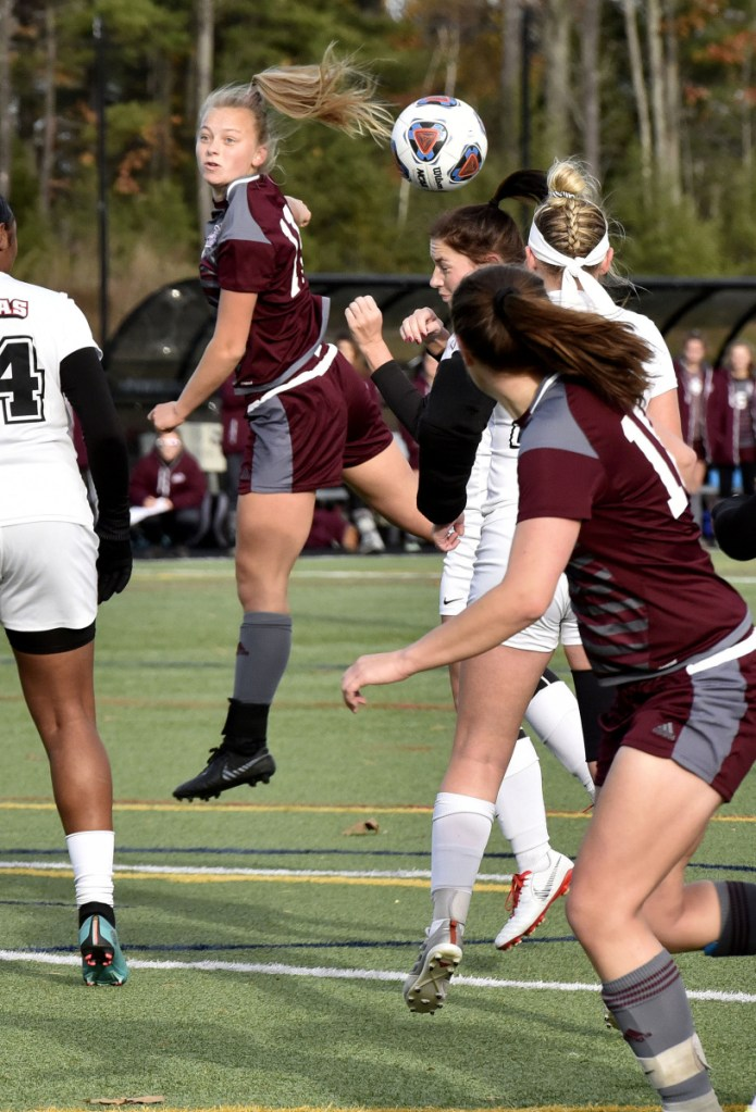 Staff photo by David Leaming   UMF's Fern Calkins, center, heads the ball during a game against Thomas College in the North Atlantic Conference championship game Sunday in Waterville.