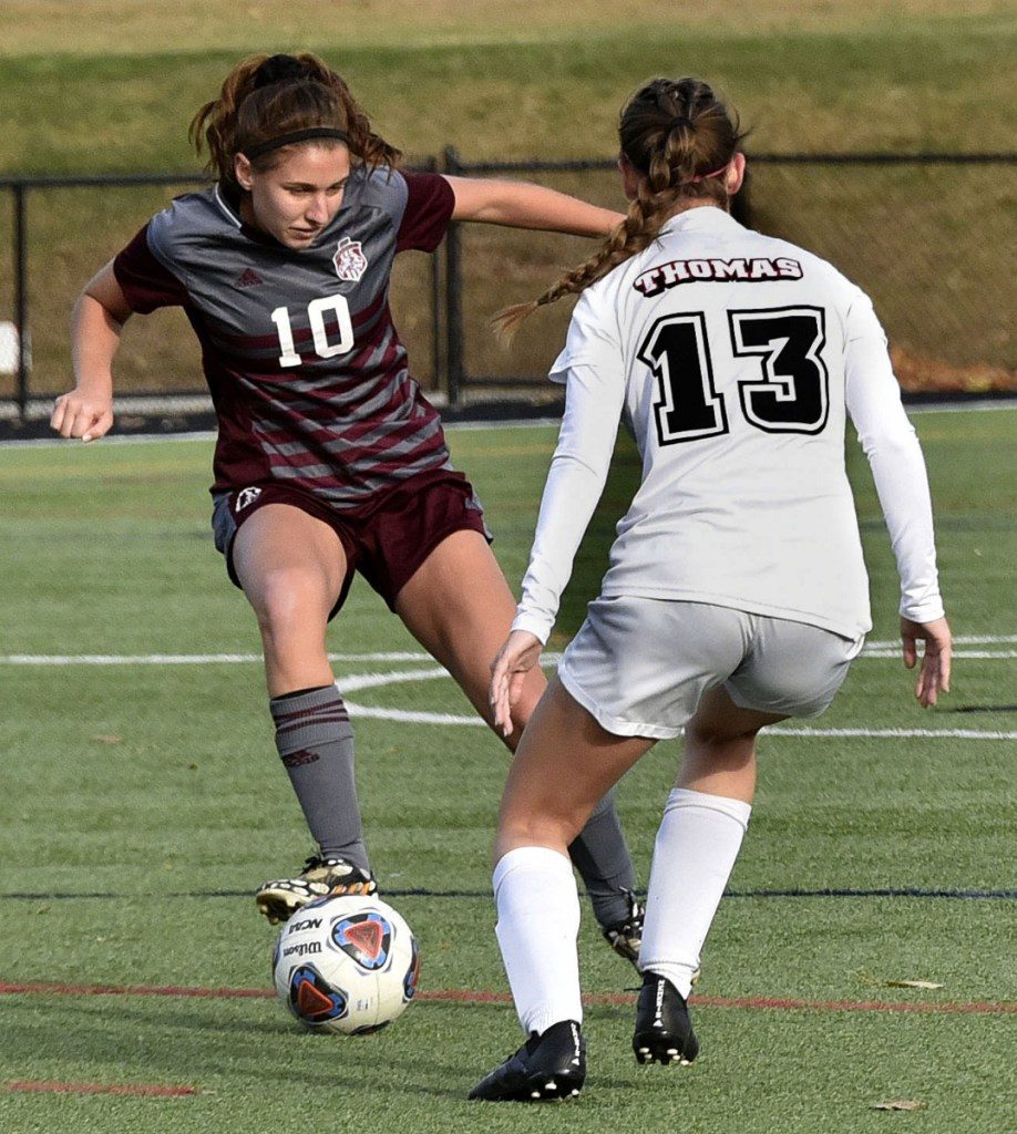 Staff photo by David Leaming   UMF's Lydia Roy (10) tries to get past Thomas College's Emily Bartlett in the North Atlantic Conference championship game Sunday in Waterville.