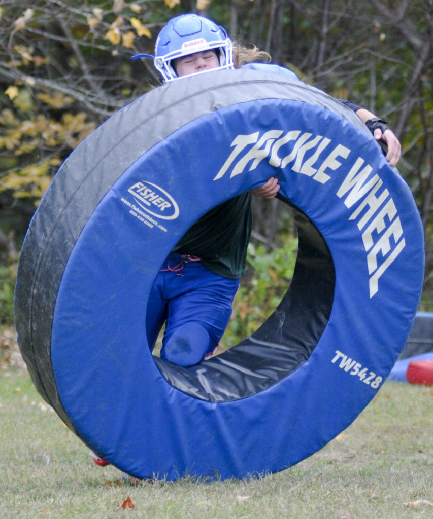 Oak Hill linebacker Ethan Richard works through a drill during a practice last month in Wales.