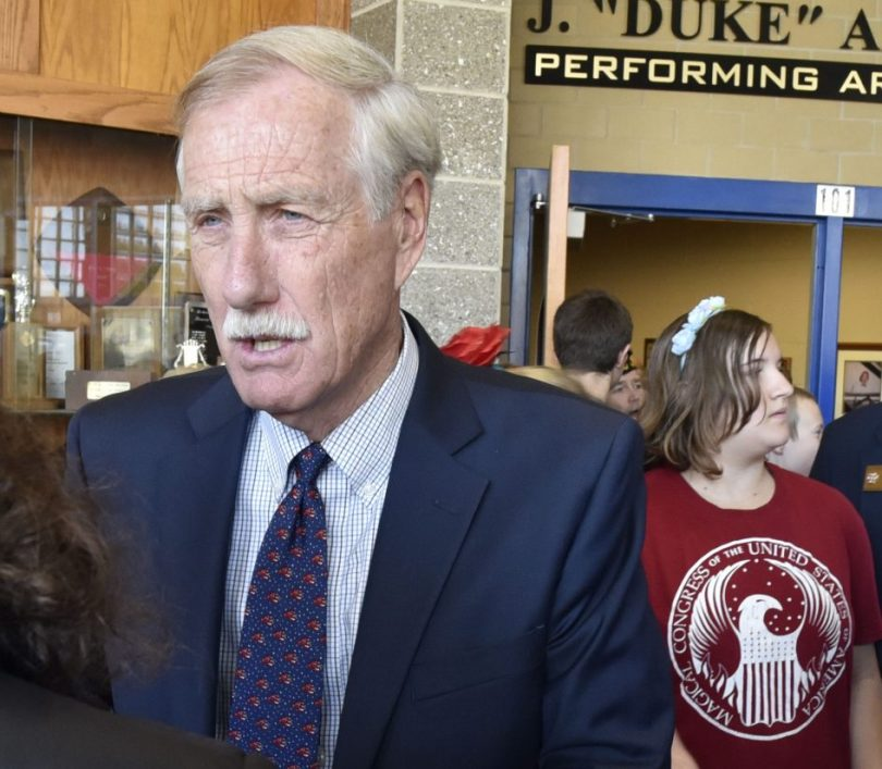 U.S. Sen. Angus King, I-Maine, speaks with reporters Thursday after a Messalonskee Middle School Veterans Day assembly at Messalonskee High School in Oakland.