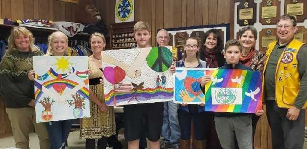 Winners of the Peace Poster Contest with their respective art teachers, from left, were Rachel Richmond and Abby St. Cyr, from Jefferson Village School; Amanda Martin and Lineo Kelley, from Whitefield Elementary; Lion Calvin Prescott; Alyvia Colfer and Sandy Dunn, from Chelsea Elementary; Nathan Hall and Genevieve Keller, from Windsor Elementary; and Lion Barry Tibbetts.