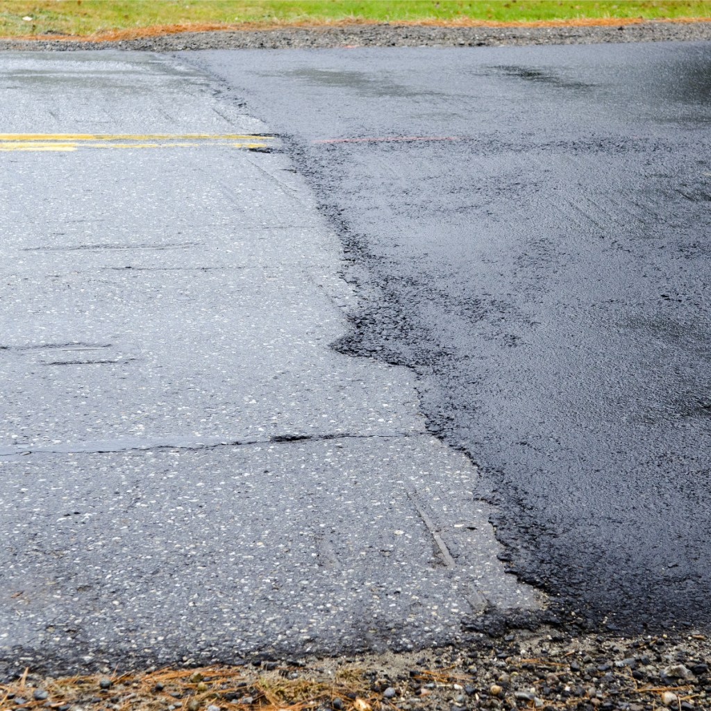 The old section of pavement, at left, appears slightly higher than the new, darker pavement level Nov. 1 on a recently repaired section of Northern Avenue in Farmingdale.
