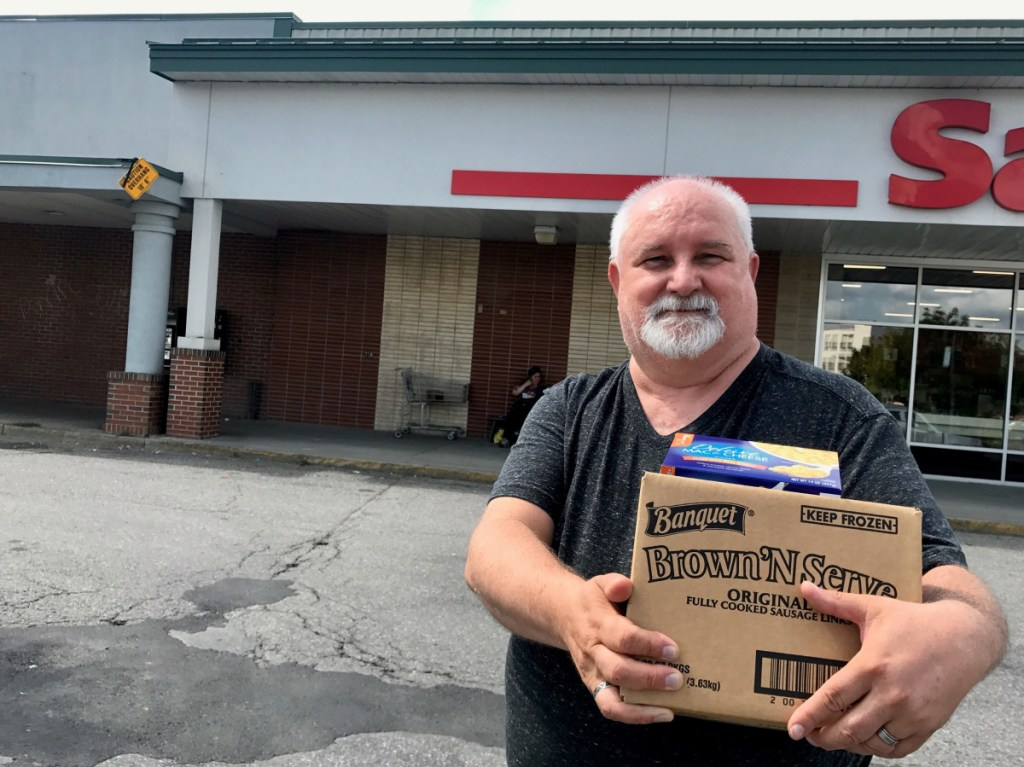 Dennis Mills, 63, of Waterville, pictured outside Save-A-Lot store on Aug. 15, said he supports a proposed ordinance that would ban plastic shopping bags at large retailers.
