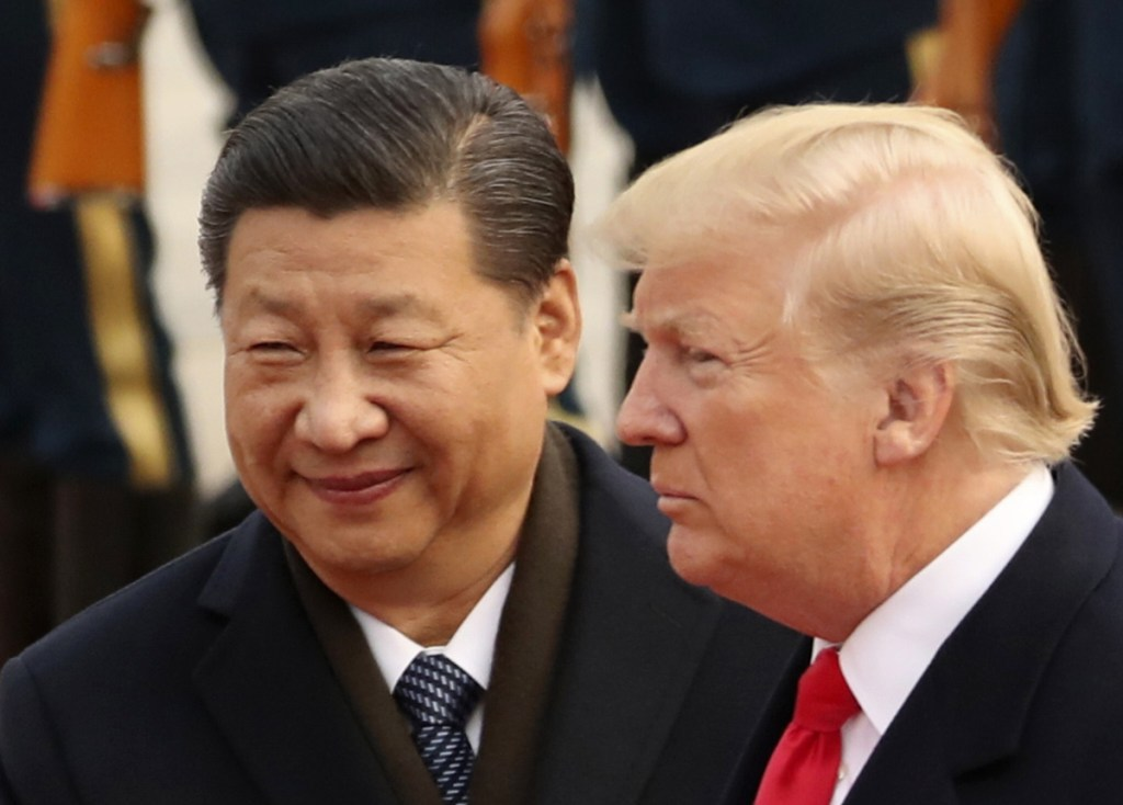 President Trump and Chinese President Xi Jinping participate in a welcome ceremony at the Great Hall of the People in Beijing about one year ago.