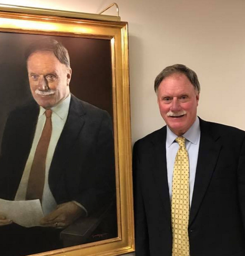 Peter Chalke stands next to his portrait in the Peter E. Chalke Wing of Central Maine Healthcare during the wing's Dec. 5, 2015, dedication.