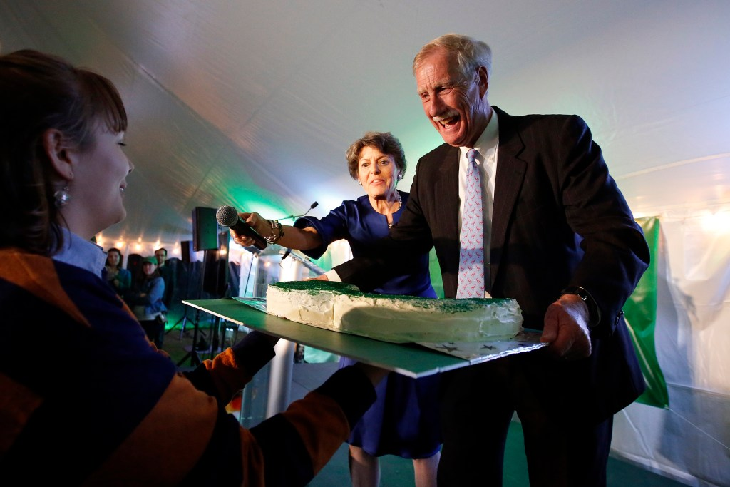 U.S. Sen. Angus King reacts as he is presented with a mustache-shaped cake shortly before announcing his re-election over candidates Eric Brakey and Zak Ringelstein on election night at Flight Deck Brewery in Brunswick.