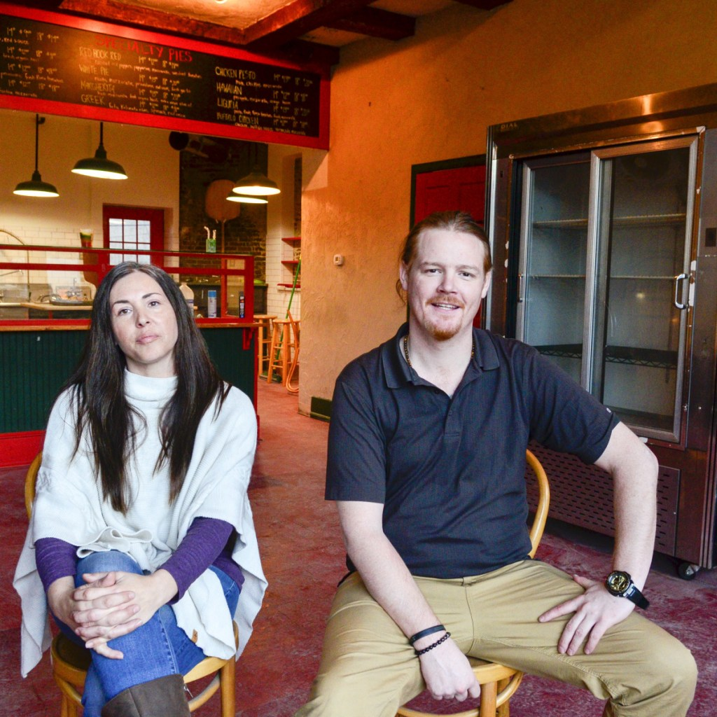 Allison Michaud, left, and Brian King sit in the former Kennebec Pizza Co. storefront on Thursday in Hallowell. They plan to open a medical marijuana retail store there named The Frost Factory.