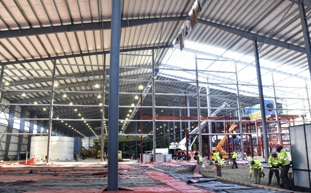 Workers continue construction inside the three-acre Fiberight Corp. solid waste processing and recycling facility in Hampden on Thursday.