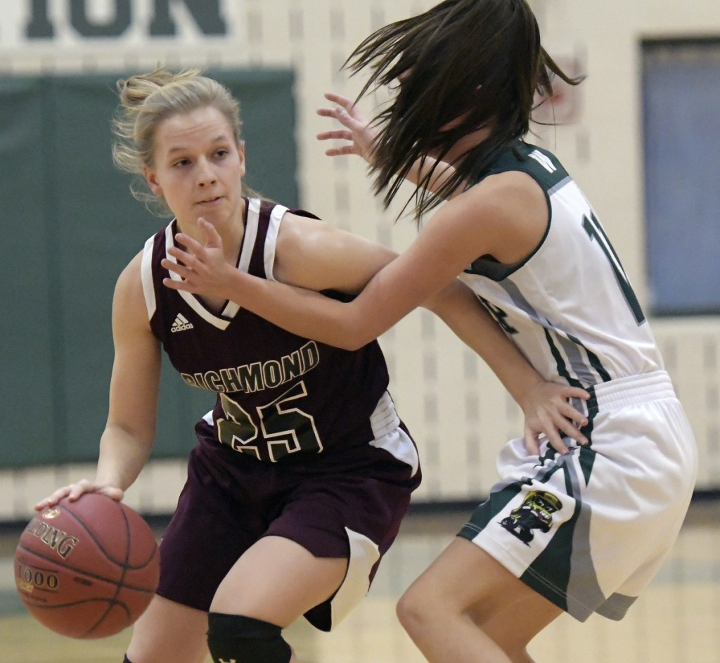 Winthrop's Jillian Schmelzer, right, guards Richmond's Caitlin Kendrick during a Mountain Valley Conference game Wednesday in Winthrop.