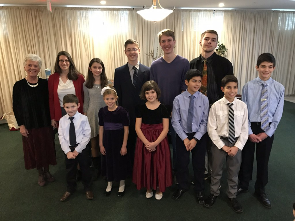 Students of Muriel Desrosiers performed during a Christmas piano and instrumental program Dec. 16 at the Goudreau's Retirement Inn in Winslow. In front, from left, are Luke Quirion,Susanna Gonnella, Maria Nawfel, Chris Nawfel, John Nawfel and Elias George Nawfel. In back, from left, are Muriel Desrosiers, Cindy Dionne, Elizabeth Dionne Gabe Cota, Richard Preston and Ian Maxwell.