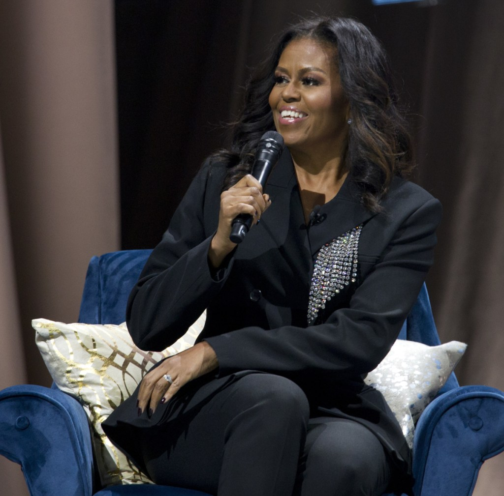 "Michelle Obama talks in Washington about her new memoir, ""Becoming."" Obama topped Gallup's annual poll of most admired women."